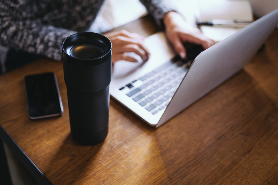 Travel Mug and Laptop